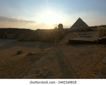 Pyramids and Sphinx in the sunset