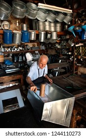 "PYRGOS, ILIA (""ELIS""), PELOPONNESE, GREECE- October 20, 2014.  Mr. Dionysis Petropoulos, tinsmith who when the photo was taken was 82 years old and had been working in the same workshop for 56 years"