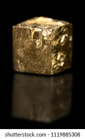 Pyrite cube mineral gemstone, yellow rough gemstone, black background