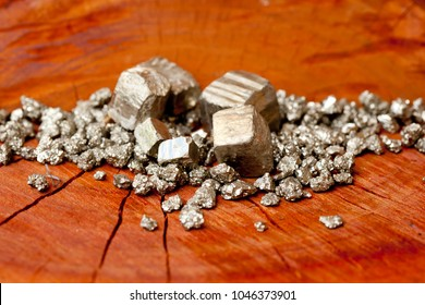 Pyrite - Fool's Gold - on wooden tree stump background