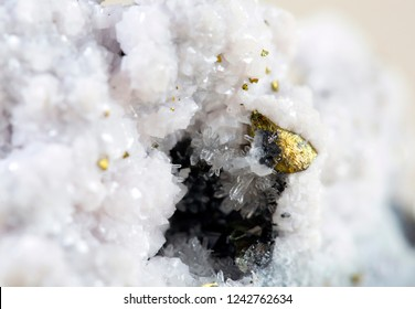 Pyrite on white background, also known as iron pyrite and fools gold