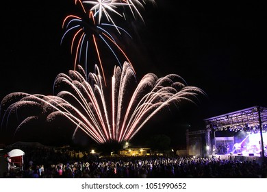 pyro fireworks with crowds and stage