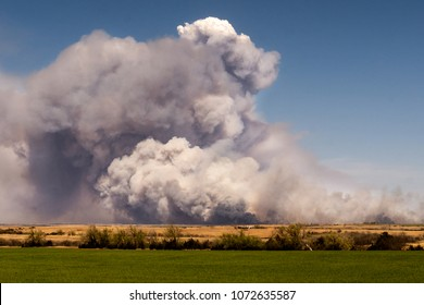A pyrocumulus cloud forms above the smoke plume of the Rhea wildfire in western Oklahoma