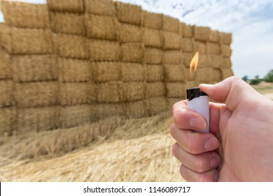 Pyromaniac with lighter ignites straw bales