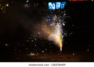a pyrotechnic product releases many sparks into the air