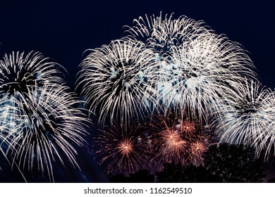 Pyrotechnic show in honor of the holiday. Scarlet Sails. The Great Pyrotechnic Show. A stunning fire festival. Celebration. Multicolored sky. Beautiful salutes.