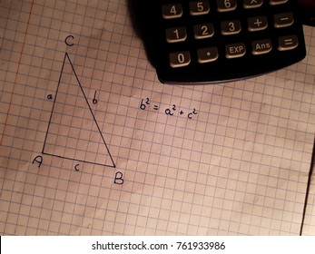 pythagoras pattern and calculator on a piece of paper