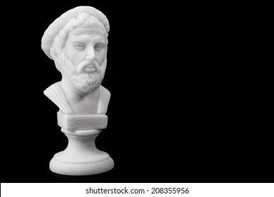 Pythagoras of Samos (570-490 B.C.E.) was an important Greek philosopher, mathematician, geometer and music theorist. Sculpture isolated on black background