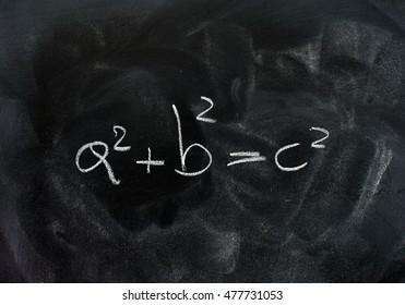 Pythagoras theorem triangle solution formula white chalk drawing on dusty black school board