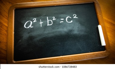 pythagorean theorem a2+b2=c2 the famous formula to calculate the hypotenuse of a triangle written on an old fashioned blackboard