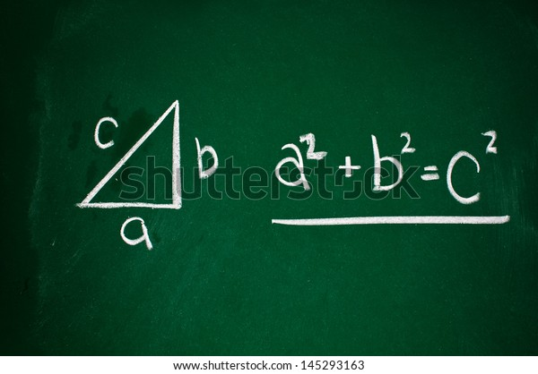 Pythagorean theorem sketched with white chalk on a chalk board