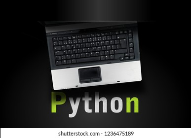 Python programming language. Laptop on word Python on black background