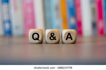 Q and A letters on a wooden cube, a question-and-answer concept.