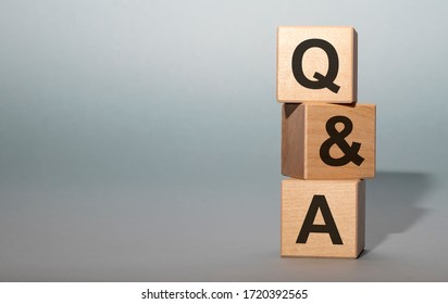 Q&A - acronym from wooden blocks with letters, questions and answers Q&A concept on grey background. Copy space available