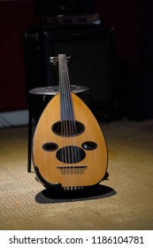 A qanbus or gambus in music studio. qanbus or Gambus is arabic music instrument shape like the guitar with rounded body.