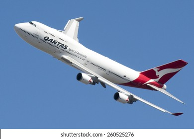 Qantas Airbus Passenger Plane flies over Melbourne City during Melbourne Formula One Grand Prix - Sunday 13th March 2015.