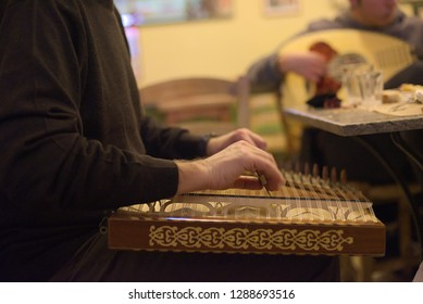 Qanun or Kanun. Musicians performing Greek music inside a coffee shop in south Greece