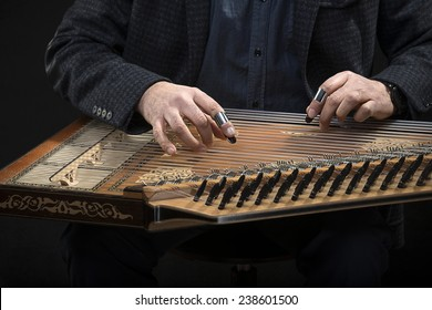 Qanun, a zither like instrument with seventy-eight strings.