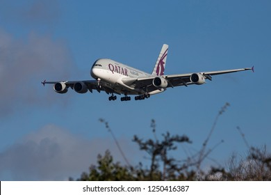 Qatar Airways Airbus A380 is landing at Heathrow Airport. The double decker aircraft has the registration A7-APJ and connects London to Doha. London, England, UK - November 30, 2018