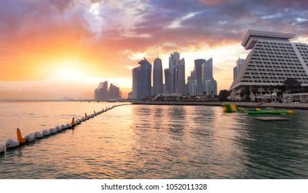 Qatar, Doha city skyline at dramatic sunset