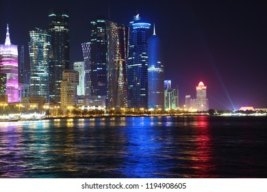 QATAR, DOHA, MARCH 20, 2018: Night financial centre in Doha - capital and most populous city in Qatar. View on Corniche road in Doha, West Bay, Persian Gulf, Arabian Peninsula, Middle East