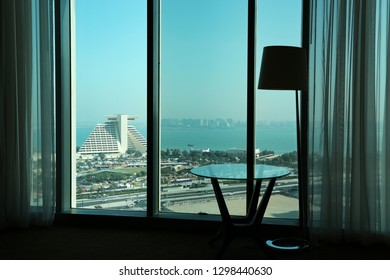 QATAR, DOHA, MARCH 22, 2018: View of coast of the Persian Gulf in Doha from big window in hotel room, Qatar, Arabian Peninsula, Middle East