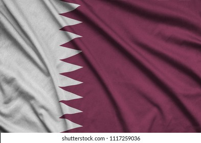 Qatar flag  is depicted on a sports cloth fabric with many folds. Sport team banner