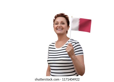 Qatar flag. Woman holding Qatar flag. Nice portrait of middle aged lady 40 50 years old with a national flag isolated on white background.