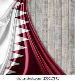 Qatar flag and wood background
