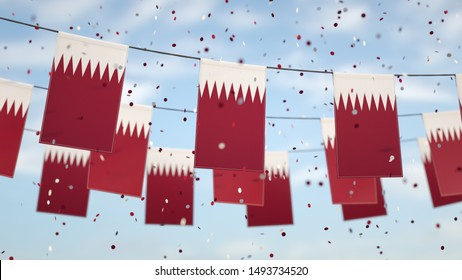 Qatar flags in the sky with confetti.