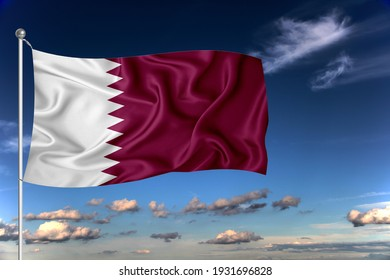 Qatar national flag waving in the wind against deep blue sky.  International relations concept.