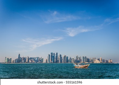 Qatar Skyline during golden hours with sambook boat