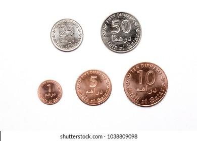Qatari coins on a white background