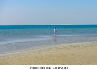 A Qatari man enjoys the beach of Selin, Al-edaid Reserve, south of Qatar, March 2015