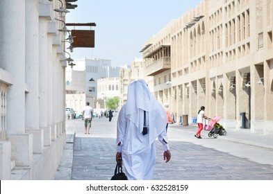 Qatary man walking in Souq Waqif Doha, Qatar