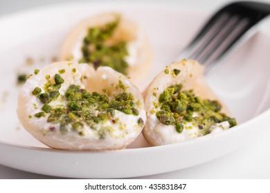 Qatayef with cream and nuts.