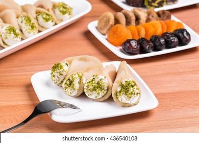 Qatayef with cream and nuts and dried Ramadan sweets