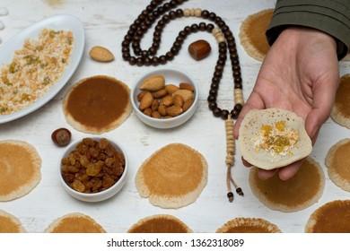 Qatayef - Muslim woman making katayef , traditional middle eastern sweets , usually eaten in Muslims holy month : Ramadan
