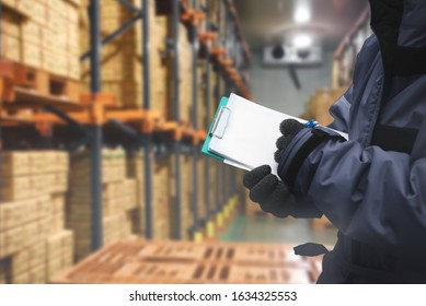 QC. worker checking goods on delivery in the cold room warehouse., Logistics food and beverage in cold storage concept - Shutterstock ID 1634325553