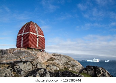 Qeqertarsuaq, Greenland - July 5, 2018: The old wooden whale watching tower. Qeqertarsuaq is a port and town located on the south coast of Disko Island on the west coast of Greenland.