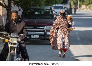 Qeshm, Iran - December 20, 2015: Bandari woman wearing a traditional mask called the burqa, Qeshm Island, Iran