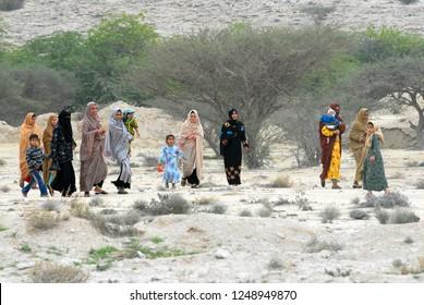 Qeshm Island, Iran - January, 2009: Authentic iranian women with cildren in desert.