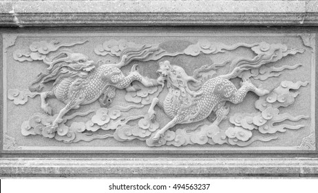 Qilin marble carved wall  at Chinese public temple. Black and White tone.