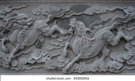 Qilin marble carved wall, Decorative Chinese art style at Chinese public temple