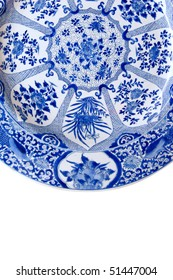 A Qing style hand painted platter. Exotic birds, plants, scrolls in cobalt blue on white porcelain.  white bkgnd.