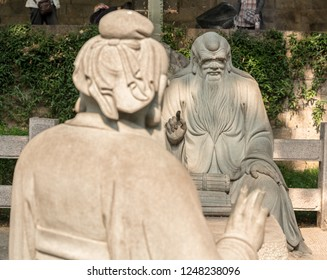 QINGDAO, CHINA - 23 OCTOBER 2018: Confucius in discussion with Lao Tze by Tai Qing Gong at Laoshan near Qingdao China