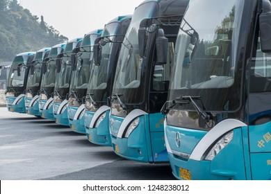 QINGDAO, CHINA - 24 OCTOBER 2018: Tour buses lined up at Laoshan near Qingdao China