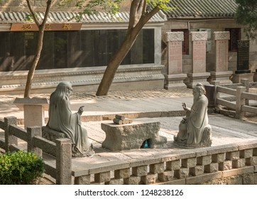 QINGDAO, CHINA - 24 OCTOBER 2018: Confucius in discussion with Lao Tze by Tai Qing Gong at Laoshan near Qingdao China