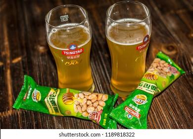Qingdao / China - August 6th 2015: Tsingtao Beer and peanuts, Tsingtao Beer Brewery, Qingdao, Shandong Province, China