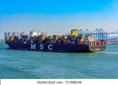 QINGDAO, CHINA - Jan 20, 2017: Heavy laden container ship CLARA by MSC departs from Qingdao Qianwan Container Terminal on delivery.